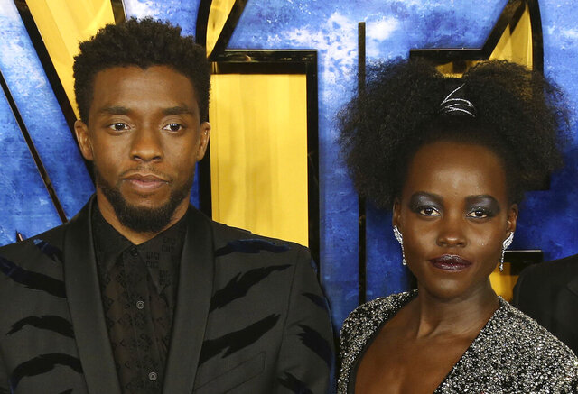 FILE - Chadwick Boseman, left, and Lupita Nyong'o arrive at the premiere of their film
