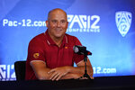 Southern California head coach Clay Helton answers questions during the Pac-12 Conference NCAA college football Media Day Tuesday, July 27, 2021, in Los Angeles. (AP Photo/Marcio Jose Sanchez)