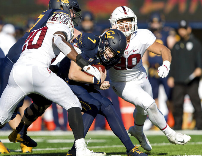 California quarterback Chase Garbers (7) is sacked by Stanford linebacker Bobby Okereke, left, and linebacker Gabe Reid in the second quarter of a football game in Berkeley, Calif., Saturday, Dec. 1, 2018. (AP Photo/John Hefti)