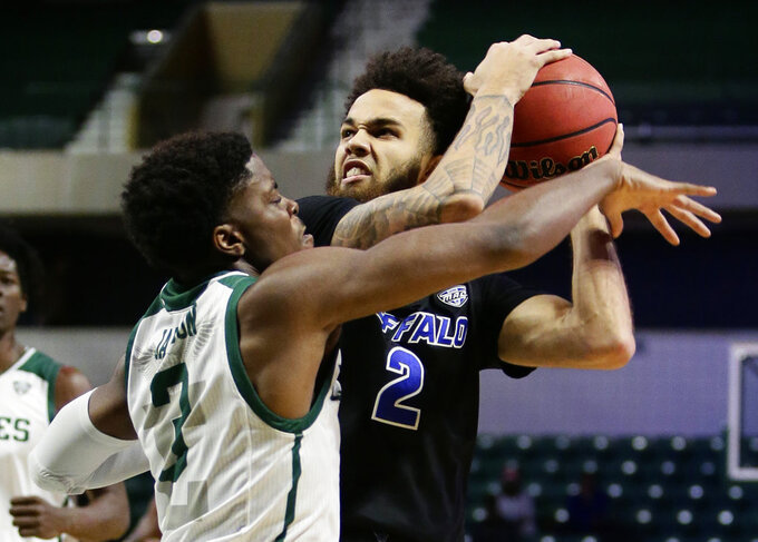Eastern Michigan guard Paul Jackson (3) tries to knock the ball away from Buffalo guard Jeremy Harris (2) during the first half of an NCAA college basketball game Friday, Jan. 4, 2019, in Ypsilanti, Mich. (AP Photo/Duane Burleson)