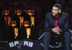 FILE - In this Dec. 18, 2016, file photo, San Antonio Spurs' Tim Duncan listens while special guests speak about him during his jersey retirement ceremony in San Antonio. Joining Kobe Bryant as first-time finalists for the Basketball Hall of Fame are: 15-time All-Star Duncan, fellow 15-time All-Star Kevin Garnett and 10-time WNBA All-Star and four-time Olympic gold medalist Tamika Catchings. (AP Photo/Darren Abate, File)