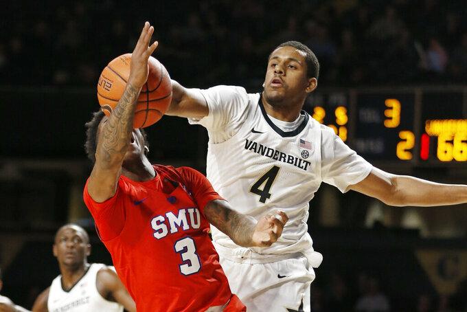 Vanderbilt guard Jordan Wright (4) blocks a shot by SMU guard Kendric Davis (3) during the second half of an NCAA college basketball game Saturday, Jan. 4, 2020, in Nashville, Tenn. (AP Photo/Mark Humphrey)