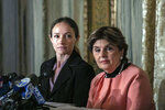 Teala Davies, left, and her attorney Gloria Allred, right, listen during a news conference, Thursday, Nov. 21, 2019, in New York, about the filing of a lawsuit against the estate of Jeffrey Epstein. Davies says she was 17 when she was victimized by Epstein. (AP Photo/Jeenah Moon)