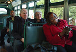 FILE - In this December 2005 file photo, Rev. Robert Graetz, second from left, and wife, Jeannie, sing along with Gladys Williams, right, on the Cleveland Avenue bus, during the walk of remembrance to commemorate the 50th anniversary of the Montgomery Bus Boycott in Montgomery, Ala. Graetz, the only white minister to support the Montgomery bus boycott, died Sunday, Sept. 20, 2020. He was 92. (Karen S. Doerr/The Montgomery Advertiser via AP)