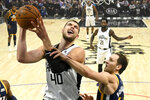 Los Angeles Clippers center Ivica Zubac, left, shoots as Utah Jazz forward Bojan Bogdanovic defends during the first half of an NBA basketball game Saturday, Dec. 28, 2019, in Los Angeles. (AP Photo/Mark J. Terrill)
