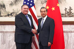 U.S. Secretary of State Mike Pompeo, left, shakes hands with Chinese Foreign Minister Wang Yi before their meeting at the Diaoyutai State Guesthouse in Beijing, Monday, Oct. 8, 2018. Pompeo said Monday that he and North Korean leader Kim Jong Un made