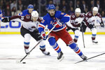 New York Rangers' Mika Zibanejad (93) drives past Colorado Avalanche's Nathan MacKinnon (29) during the second period of an NHL hockey game Tuesday, Jan. 7, 2020, in New York. (AP Photo/Frank Franklin II)