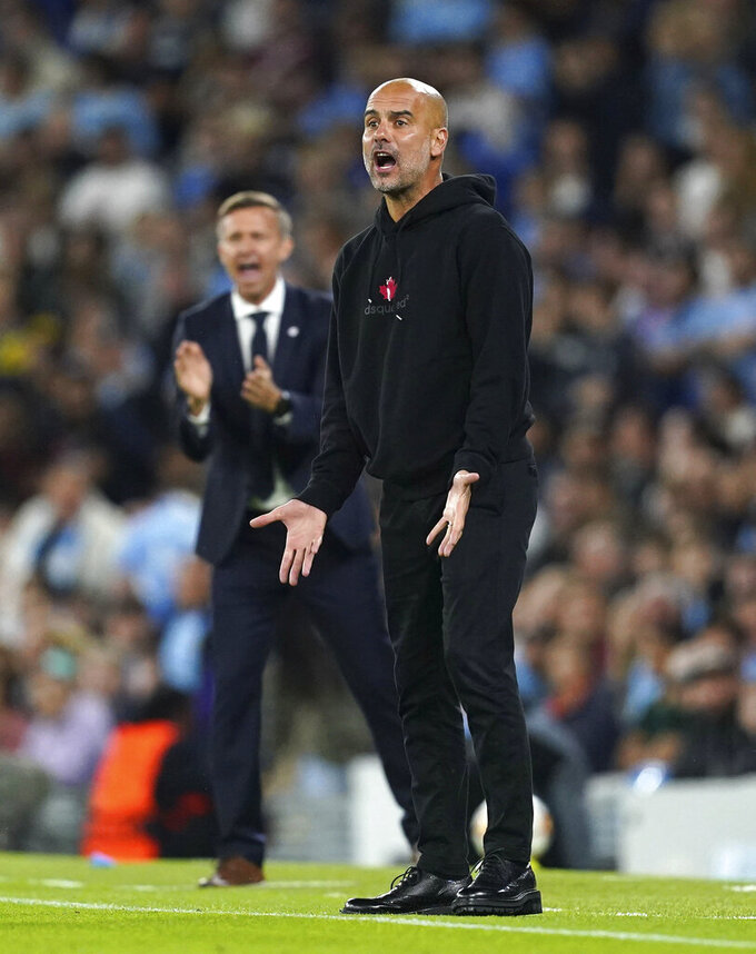 Manchester City manager Pep Guardiola on the touchline during the Champions League Group A soccer match between Manchester City and RB Leipzig at the Etihad Stadium, Manchester, England, Wednesday Sept. 15, 2021. (Martin Rickett/PA via AP)