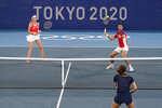 Novak Djokovic, right, and Nina Sojanovic, of Serbia, return to Luisa Stefani, bottom right, and Marcelo Melo, of Brazil, during a first round mixed doubles tennis match at the 2020 Summer Olympics, Wednesday, July 28, 2021, in Tokyo, Japan. (AP Photo/Patrick Semansky)