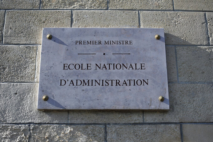 FILE - In this Thursday, Feb. 11, 2021 file photo, a plaque is pictured at the entrance of the French National School of Administration, (ENA), in Paris. French President Emmanuel Macron on Thursday, April 8, 2021 detailed plans to do away with an elite academic institution that's a key symbol of the country's power establishment, replacing it with a more egalitarian version. Macron was addressing hundreds of civil servants by video conference about planned reforms in the top ranks of the civil service, including putting an end to the Ecole Nationale d'Administration, widely known as ENA. (AP Photo/Francois Mori, FIle)