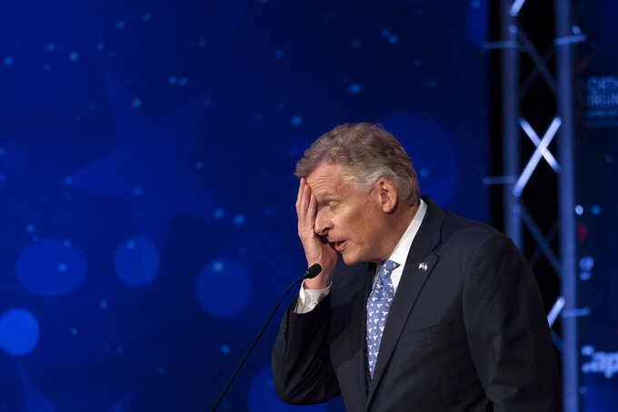 Virginia Democratic gubernatorial candidate and former Gov. Terry McAuliffe participates with his Republican challenger, Glenn Youngkin, in a debate at Northern Virginia Community College, in Alexandria, Va., Tuesday, Sept. 28, 2021. (AP Photo/Cliff Owen)