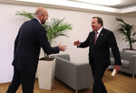 Swedish Prime Minister Stefan Lofven, right, is greeted by European Council President Charles Michel prior to a bilateral meeting at an EU summit in Brussels, Thursday, Feb. 20, 2020. After almost two years of sparring, the EU will be discussing the bloc's budget to work out Europe's spending plans for the next seven years. (Virginia Mayo, Pool)