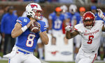 SMU quarterback Ben Hicks looks for an open receiver as Houston linebacker Emeke Egbule (8) pressures during the first half of an NCAA college football game Saturday, Nov. 3, 2018, in Dallas. (AP Photo/Brandon Wade)