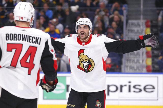 Ottawa Senators defenseman Mark Borowiecki (74) celebrates his goal with teammate Dylan DeMelo (2) during the third period of an NHL hockey game against the Buffalo Sabres, Tuesday, Jan. 28, 2020, in Buffalo, N.Y. (AP Photo/Jeffrey T. Barnes)