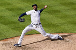 New York Yankees relief pitcher Aroldis Chapman winds up during the ninth inning of a baseball game against the Baltimore Orioles, Sunday, Sept. 13, 2020, at Yankee Stadium in New York. Chapman earned a save in the Yankees win over the Orioles. (AP Photo/Kathy Willens)
