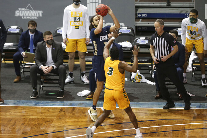 Oral Roberts guard Kareem Thompson (2) shoots a 3-pointer against North Dakota State during the first half of an NCAA college basketball game for the Summit League men's tournament championship Tuesday, March 9, 2021, in Sioux Falls, S.D. (AP Photo/Josh Jurgens)