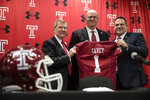Temple University's President Richard Englert, left, and director of athletics, Patrick Kraft, right, pose for photographs with incoming head coach Rod Carey, center, speaks during an NCAA college football news conference in Philadelphia, Friday, Jan. 11, 2019. (AP Photo/Matt Rourke)