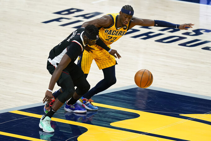 Los Angeles Clippers' Reggie Jackson (1) is fouled by Indiana Pacers' Caris LeVert (22) during the second half of an NBA basketball game, Tuesday, April 13, 2021, in Indianapolis. (AP Photo/Darron Cummings)