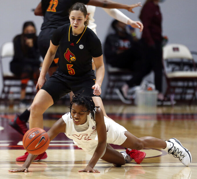 Virginia Tech's Aisha Sheppard, bottom, falls after colliding with Louisville's Mykasa Robinson (5) in the second half of an NCAA college basketball game Thursday, Jan. 7, 2021, in Blacksburg, Va. (Matt Gentry/The Roanoke Times via AP, Pool)