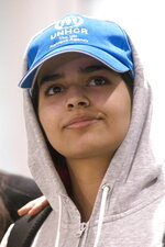 Rahaf Mohammed Alqunun, 18, arrives at Toronto Pearson International Airport, on Saturday, Jan.12, 2019.  The Saudi teen fled her family while visiting Kuwait and flew to Bangkok, where she barricaded herself in an airport hotel and launched a Twitter campaign that drew global attention to her case. Prime Minister Justin Trudeau announced his government would accept her as a refugee.  (Chris Young/The Canadian Press via AP)