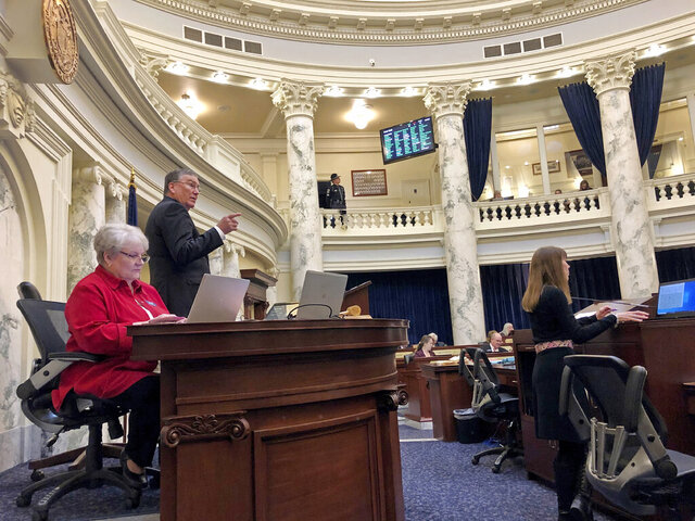 The Idaho House ended its legislative session after balancing fears of spreading the coronavirus with potential vetoes of several bills they will now be powerless to override Friday, March 20, 2020, in Boise, Ohio. The House voted 32-28 Friday to end the session a day after the Senate went home. Republican House Speaker Scott Bedke says that if not for the virus, the House would have remained in session to override vetoes. (AP Photo/Keith Ridler)