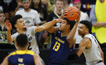 UC Irvine forward Austin Johnson (13) goes up for a basket between Colorado guards Daylen Kountz, left, and Tyler Bey in the second half of an NCAA college basketball game Monday, Nov. 18, 2019, in Boulder, Colo. (AP Photo/David Zalubowski)