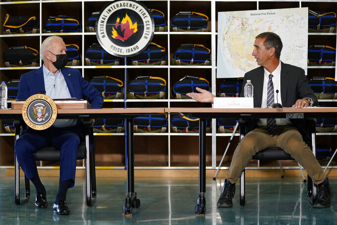 President Joe Biden listens to Grant Beebe, Assistant Director for Fire and Aviation at the Bureau of Land Management during a visit to the National Interagency Fire Center, Monday, Sept. 13, 2021, in Boise, Idaho. (AP Photo/Evan Vucci)