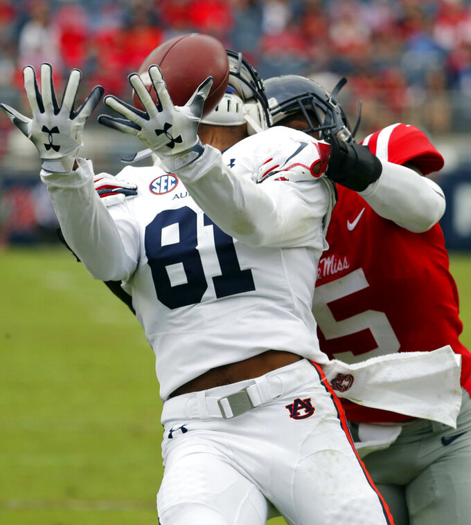Mississippi defensive back Ken Webster (5) knocks away a pass intended for Auburn wide receiver Darius Slayton (81) during the first half of an NCAA college football game on Saturday, Oct. 20, 2018, in Oxford, Miss. (AP Photo/Rogelio V. Solis)