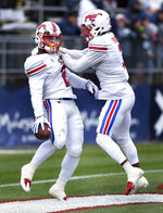 SMU running back Ke'Mon Freeman (2) celebrates with wide receiver James Proche (3) after Freeman scored a touchdown in the first half of an NCAA college football game against Connecticut, Saturday, Nov. 10, 2018, in East Hartford, Conn.(AP Photo/Stephen Dunn)