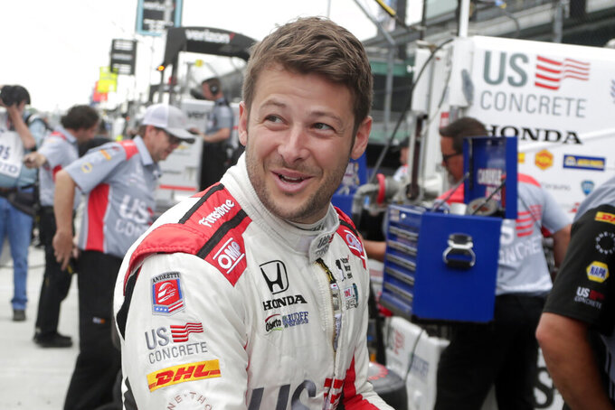 FILE - In this Friday, May 18, 2018, file photo, Marco Andretti prepares to drive during a practice session for the IndyCar Indianapolis 500 auto race at Indianapolis Motor Speedway, in Indianapolis. Ice-T says there is no one he's rooting for in Sunday's, Aug. 23, 2020, Indianapolis 500 like pole sitter Marco Andretti. The unlikely friends have been tight for close to a decade. (AP Photo/Michael Conroy, File)