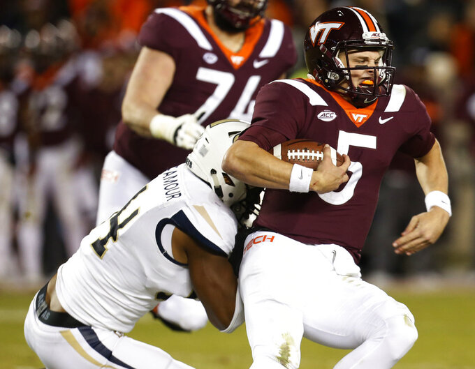 Virginia Tech quarterback Ryan Willis (5) is sacked by Georgia Tech defensive lineman Anree Saint-Amour (94) during the second half of an NCAA college football game in Blacksburg, Va., Thursday, Oct. 25, 2018. Georgia Tech defeated Virginia Tech 49-28. (AP Photo/Steve Helber)