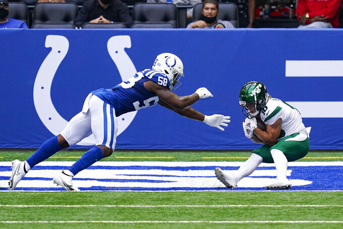New York Jets wide receiver Braxton Berrios (10) catches a pass for a touchdown in front of Indianapolis Colts inside linebacker Bobby Okereke (58) the first half of an NFL football game in Indianapolis, Sunday, Sept. 27, 2020. (AP Photo/Darron Cummings)