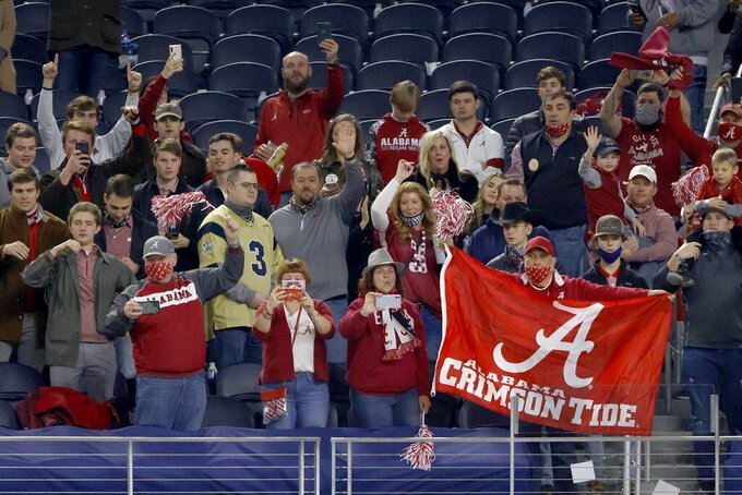 Alabama fans celebrate their teams 31-14 win against Notre Dame in the Rose Bowl NCAA college football game in Arlington, Texas, Friday, Jan. 1, 2021. (AP Photo/Ron Jenkins)