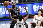 Brooklyn Nets' Jeff Green (8) shoots over New Orleans Pelicans' Naji Marshall (8) as Jaxson Hayes (10) reacts during the first half of an NBA basketball game Wednesday, April 7, 2021, in New York. (AP Photo/Frank Franklin II)