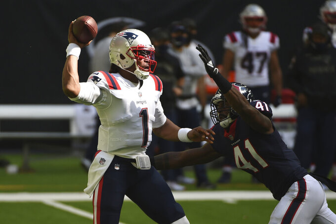 New England Patriots quarterback Cam Newton (1) is pressured by Houston Texans inside linebacker Zach Cunningham (41) a he looks to pass during the first half of an NFL football game, Sunday, Nov. 22, 2020, in Houston. (AP Photo/Eric Christian Smith)