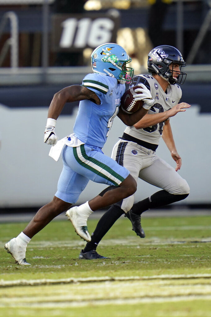 Tulane's Jha'Quan Jackson runs a 52-yard punt return past Central Florida punter Andrew Osteen during the second half of an NCAA college football game, Saturday, Oct. 24, 2020, in Orlando, Fla. (AP Photo/John Raoux)