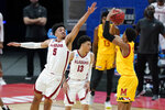 Alabama's Jaden Shackelford (5) tries to block the shot of Maryland's Aaron Wiggins (2) during the first half of a college basketball game in the second round of the NCAA tournament at Bankers Life Fieldhouse in Indianapolis Monday, March 22, 2021. (AP Photo/Mark Humphrey)