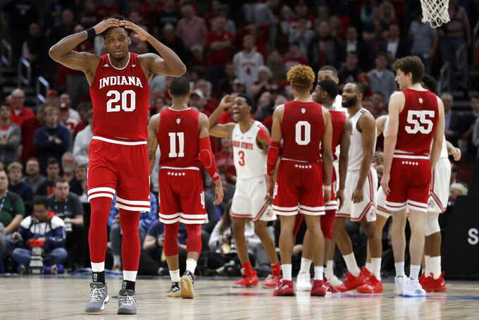 Indiana's De'Ron Davis (20) reacts to an offensive foul call during the second half of an NCAA college basketball game against the Ohio State in the second round of the Big Ten Conference tournament, Thursday, March 14, 2019, in Chicago. The Ohio State won 79-75. (AP Photo/Nam Y. Huh)