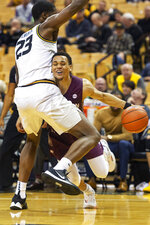 Southern Illinois' Eric McGill, right, dribbles his way around Missouri's Jeremiah Tilmon, left, during the first half of an NCAA college basketball game Sunday, Dec. 15, 2019, in Columbia, Mo. (AP Photo/L.G. Patterson)