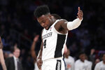 Providence guard Maliek White reacts after a basket against Butler during the second half of an NCAA college basketball game in the Big East men's tournament Wednesday, March 13, 2019, in New York. Providence won 80-57. (AP Photo/Julio Cortez)
