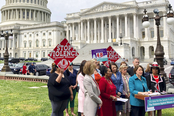 Sen. Amy Klobuchar, D-Minn., urges Senate to take up a bill renewing the Violence Against Women Act at a news conference Wednesday, May 22, 2019, outside the U.S. Capitol in Washington. (AP Photo/Matthew Daly)