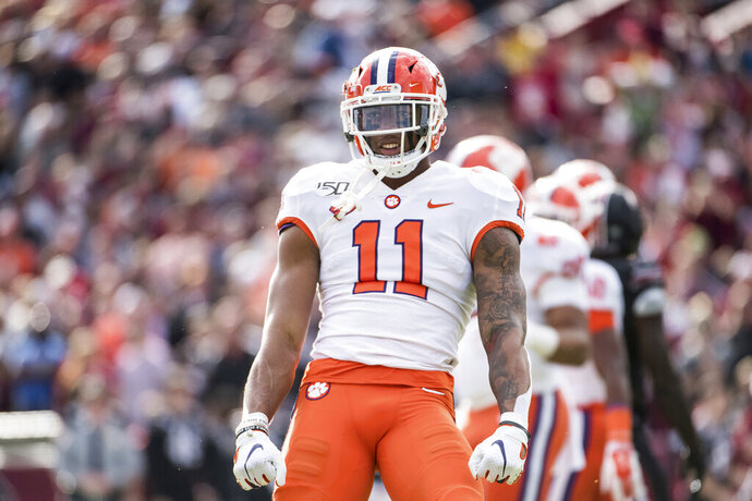 FILE - In this Nov. 30, 2019, file photo, Clemson linebacker Isaiah Simmons (11) celebrates a stop against South Carolina during an NCAA college football game, in Columbia, S.C. Simmons was selected to The Associated Press All-America team, Monday, Dec. 16, 2019.(AP Photo/Sean Rayford, File)