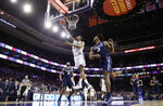 Villanova's Jermaine Samuels, left, goes up for a shot past Xavier's Quentin Goodin during the second half of an NCAA college basketball game Friday, Jan. 18, 2019, in Philadelphia. Villanova won 85-75. (AP Photo/Matt Slocum)