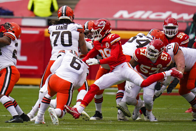 Cleveland Browns quarterback Baker Mayfield (6) is sacked by Kansas City Chiefs safety L'Jarius Sneed (38) during the first half of an NFL divisional round football game, Sunday, Jan. 17, 2021, in Kansas City. (AP Photo/Jeff Roberson)