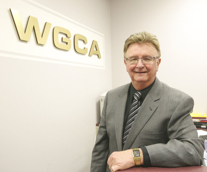 Rev. Bruce Rice of WGCA poses in studio lobby in Quincy on March 28, 2011.  (Phil Carlson/Quincy Herald-Whig via AP)