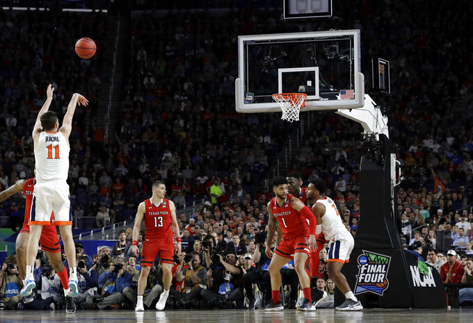 Virginia guard Ty Jerome (11) shoots a three-point basket over Texas Tech guard Matt Mooney (13) during the first half in the championship game of the Final Four NCAA college basketball tournament, Monday, April 8, 2019, in Minneapolis. (AP Photo/David J. Phillip)