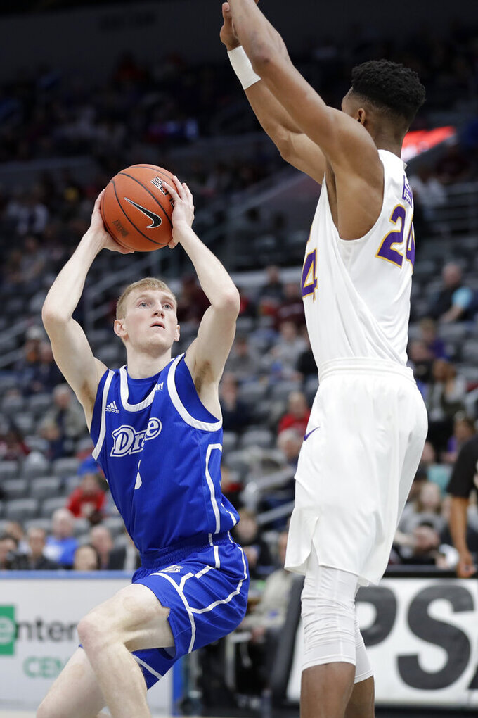 Drake's Garrett Sturtz, left, looks to the basket as Northern Iowa's Isaiah Brown defends during the first half of an NCAA college basketball game in the quarterfinal round of the Missouri Valley Conference men's tournament Friday, March 6, 2020, in St. Louis. (AP Photo/Jeff Roberson)