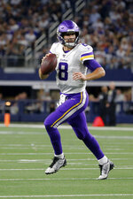 Minnesota Vikings quarterback Kirk Cousins scrambles our of the pocket during the second half of the team's NFL football game against the Dallas Cowboys in Arlington, Texas, Sunday, Nov. 10, 2019. (AP Photo/Michael Ainsworth)