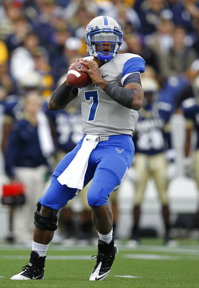 FILE In this Oct. 1, 2011, file photo, Air Force quarterback Tim Jefferson Jr. drops back to pass during the first quarter of an NCAA college football game against Navy in Annapolis, Md. The attacks on Sept. 11, 2001 played a role in Jefferson's decision to join the Air Force. (AP Photo/Luis M. Alvarez, File)