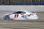 Denny Hamlin celebrates after winning the YellaWood 500 NASCAR auto race at Talladega Superspeedway, Sunday, Oct. 4, 2020, in Talladega, Ala. (AP Photo/John Bazemore)